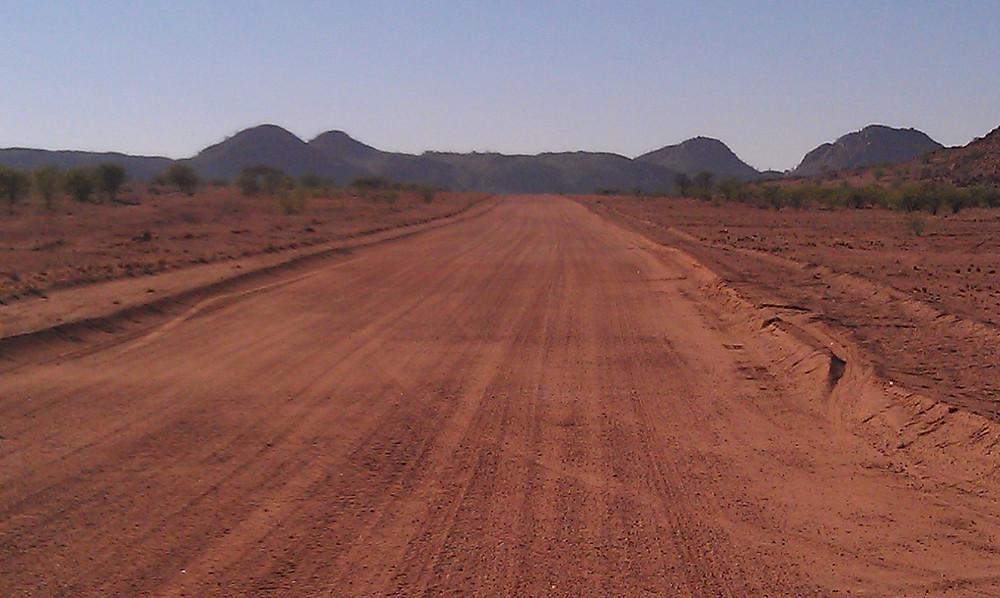 view of red dirt road in Namib desert, Namibia