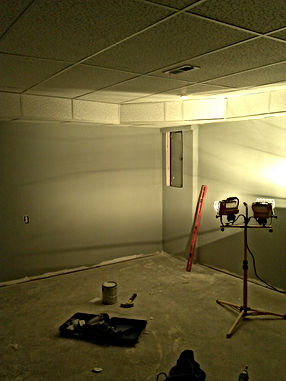 Finished drywall with drop down ceiling.