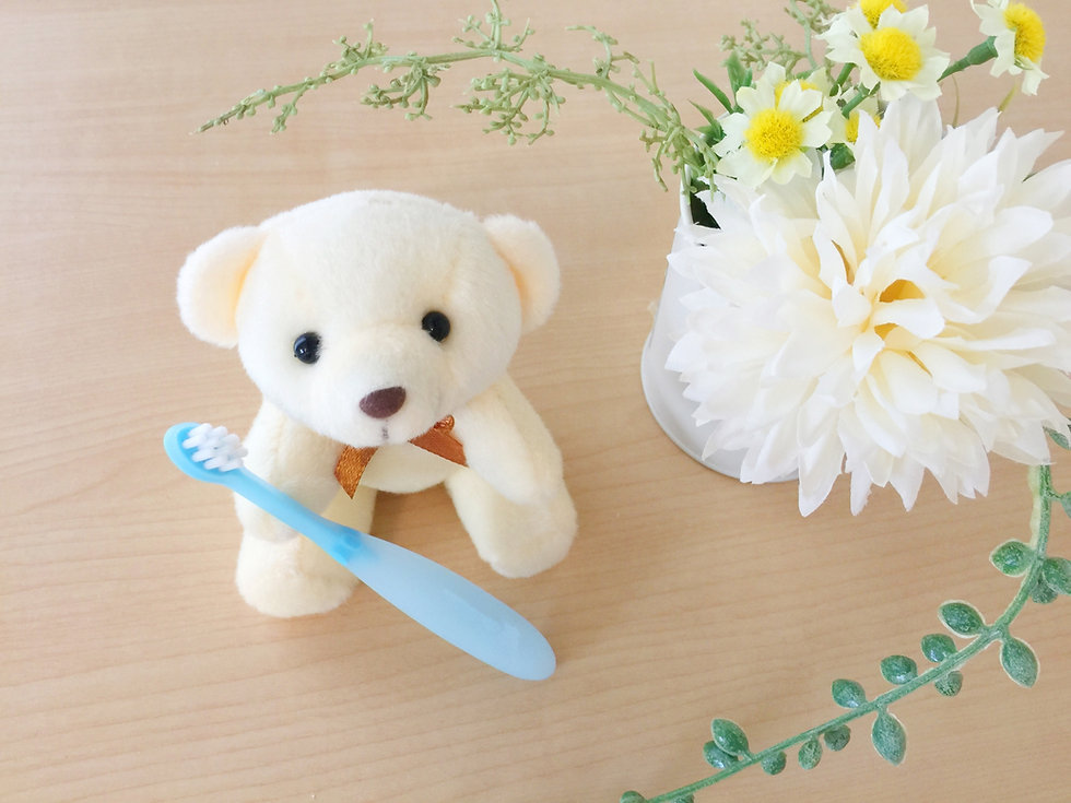 熊のぬいぐるみと歯ブラシ