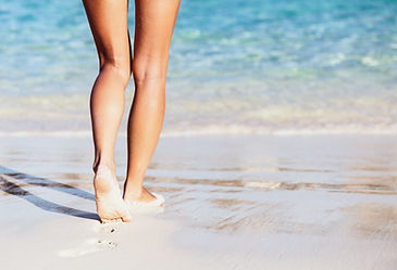 Woman walking into the sea, body part, p