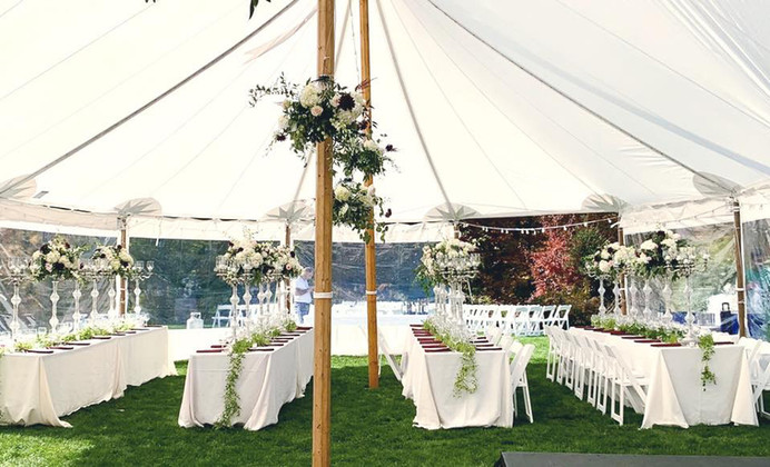 Tent Decorated with Hanging Florals and Formal Table Decor