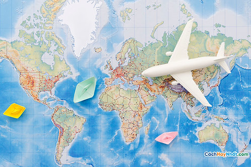 Bản Đồ Thế Giới flat lay of map with airplane toy