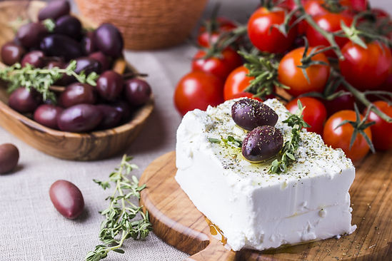 Greek cheese feta with thyme and olives,