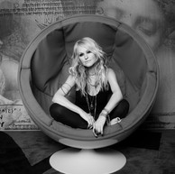 Mindi Abair Sits in the Red Chair