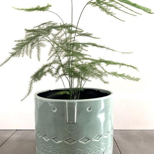 Footed aqua glazed friendly faces planter