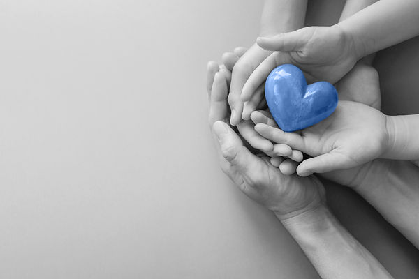 adult-and-child-hands-holding-heart-b&w