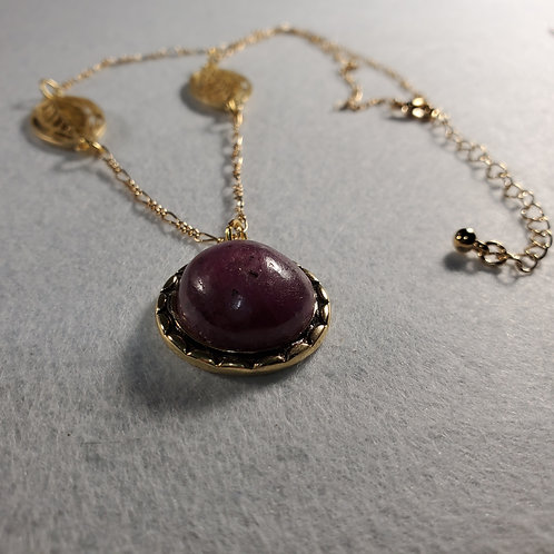Ruby pendant on gold plated chain.