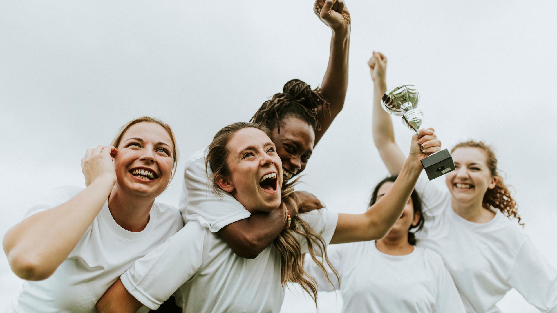 Female football players celebrating thei