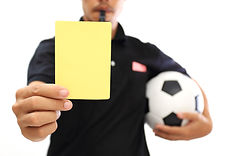 Referee showing a yellow card on white b