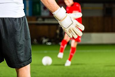 Man scoring a goal at indoor football or