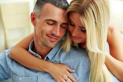 couple-hugging-with-eyes-closed-at-home_