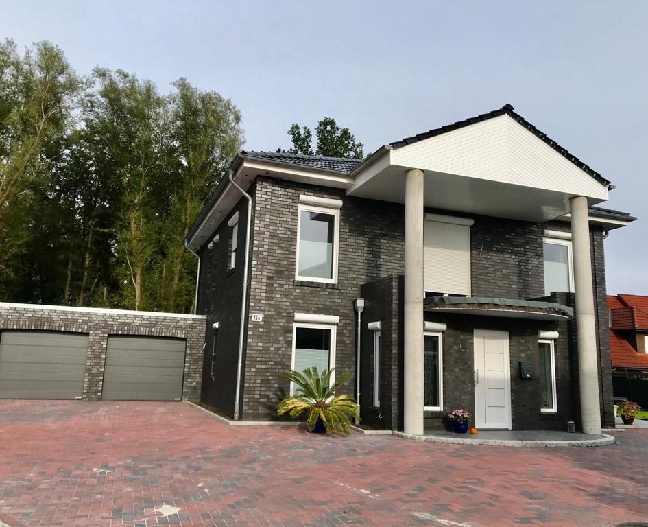 Neubau eines Einfamilieshauses in Holzrahmenbau mit Doppelgaage