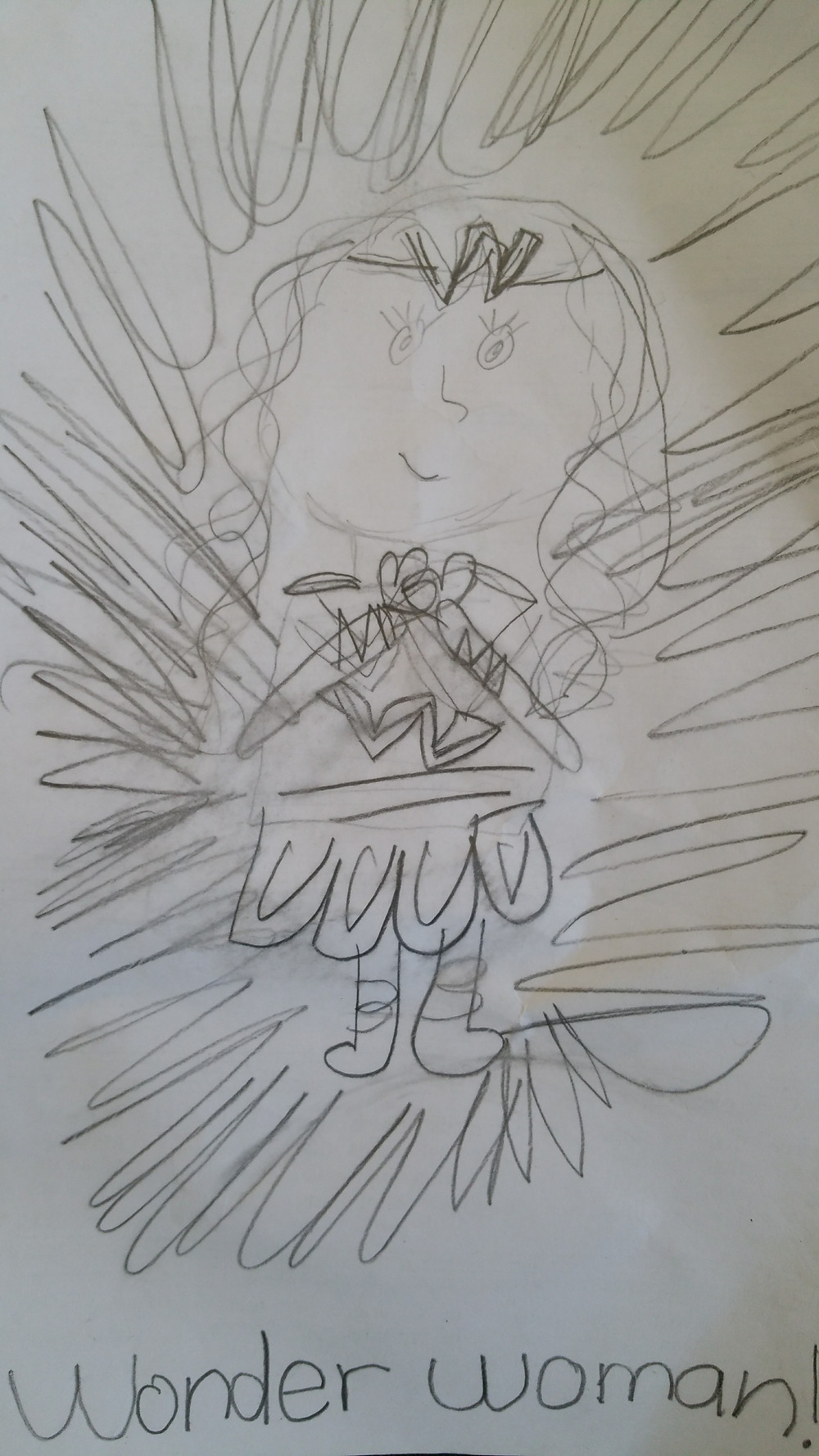 child's pencil drawing of Wonder Woman