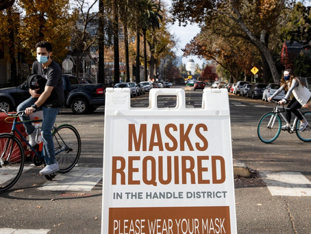 Here's Why Vaccinated People Still Need to Wear a Mask