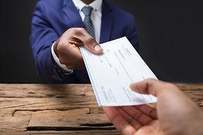 employeer handing employee a check