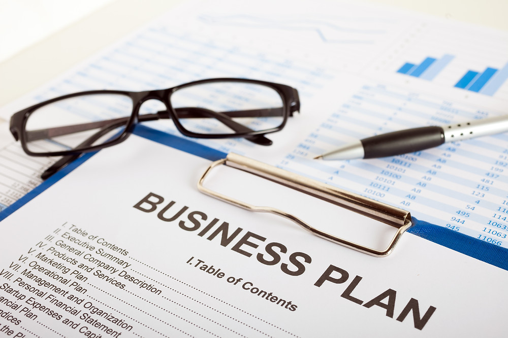 Checklist labled business plan overlaying two graphs