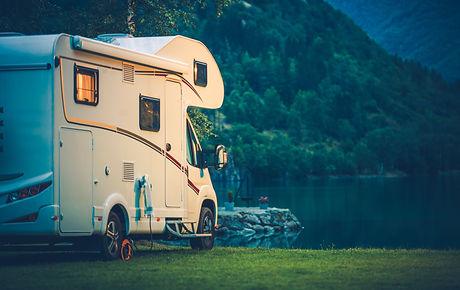 Camper Camping at the Glacier Lake. Camp