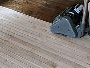 Sanding hardwood floor with the grinding