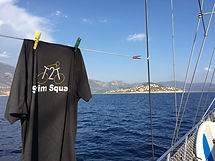 Swim squad t shirt on a boat.JPG