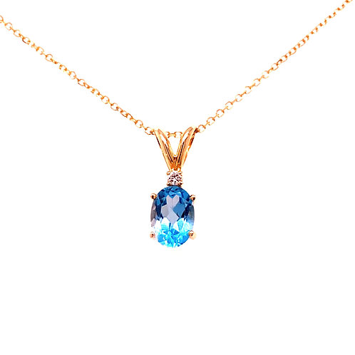 14kt Yellow Gold Oval  Blue Topaz And Diamond Pendant