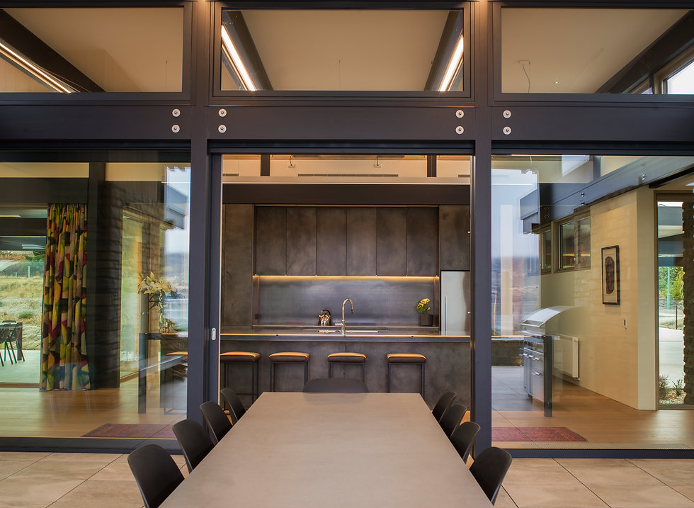 Stunning kitchen in Wanaka, New Zealand which has been coated in Lightly Aged Nickle Silver.