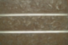 Designer Slatwall with Metalier Iron textured metal finish with slight rust effect.