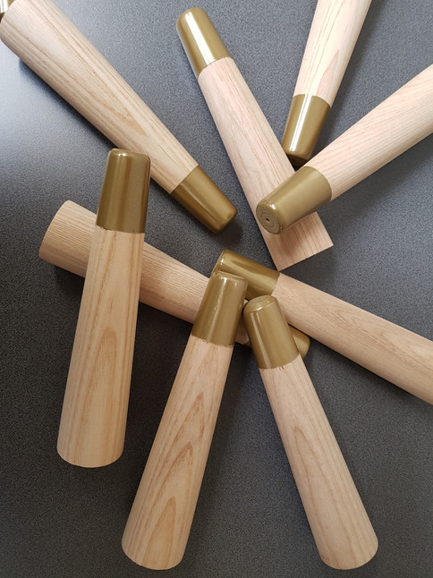 Timber chair legs with Metalier Brass tips.