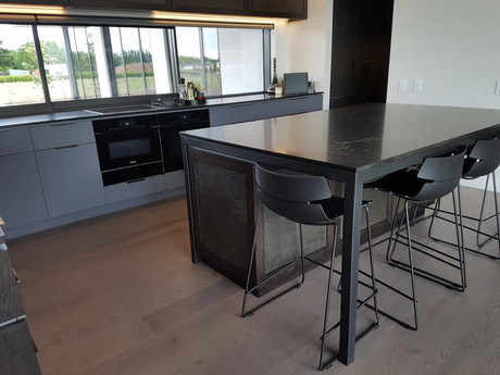 Kitchen island with steel inserts coated in Bronze Reinforced texture which has been aged.