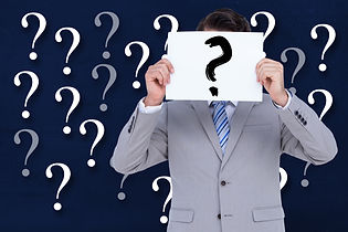 man-with-sign-with-question-mark-and-background-with-question-marks-min.jpg