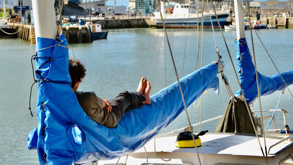 boy asleep on sail.jpg