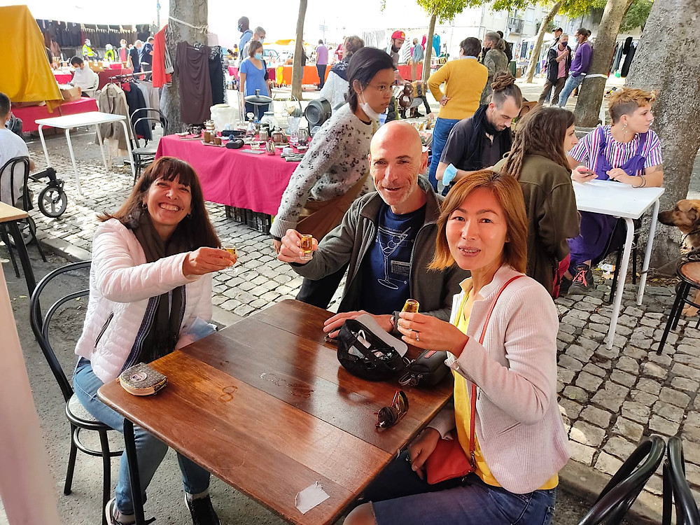 Taste-testing local shots at Feira da Ladra, Lisboa