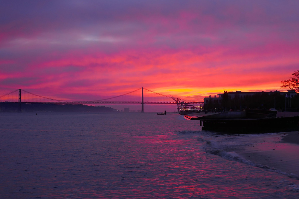 Amazing sunset over the April 25th Bridge, Lisbon