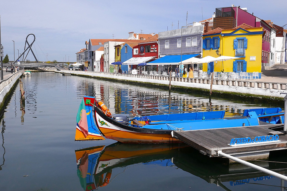 Colourful canal boats matching colourful houses in Aveiro