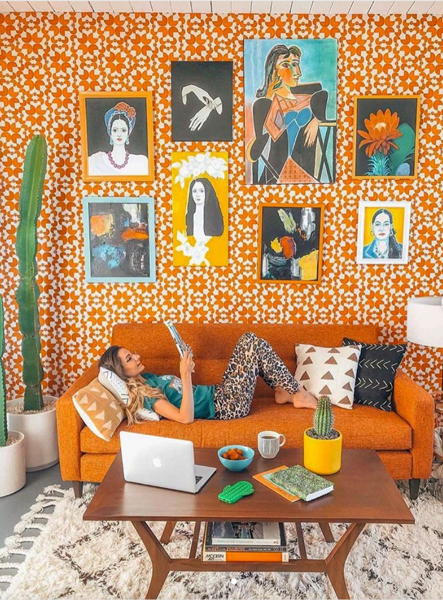 Mid-century modern living room, orange sofa, shag rug, orange wallpaper, wallpaper, art gallery, art gallery wall