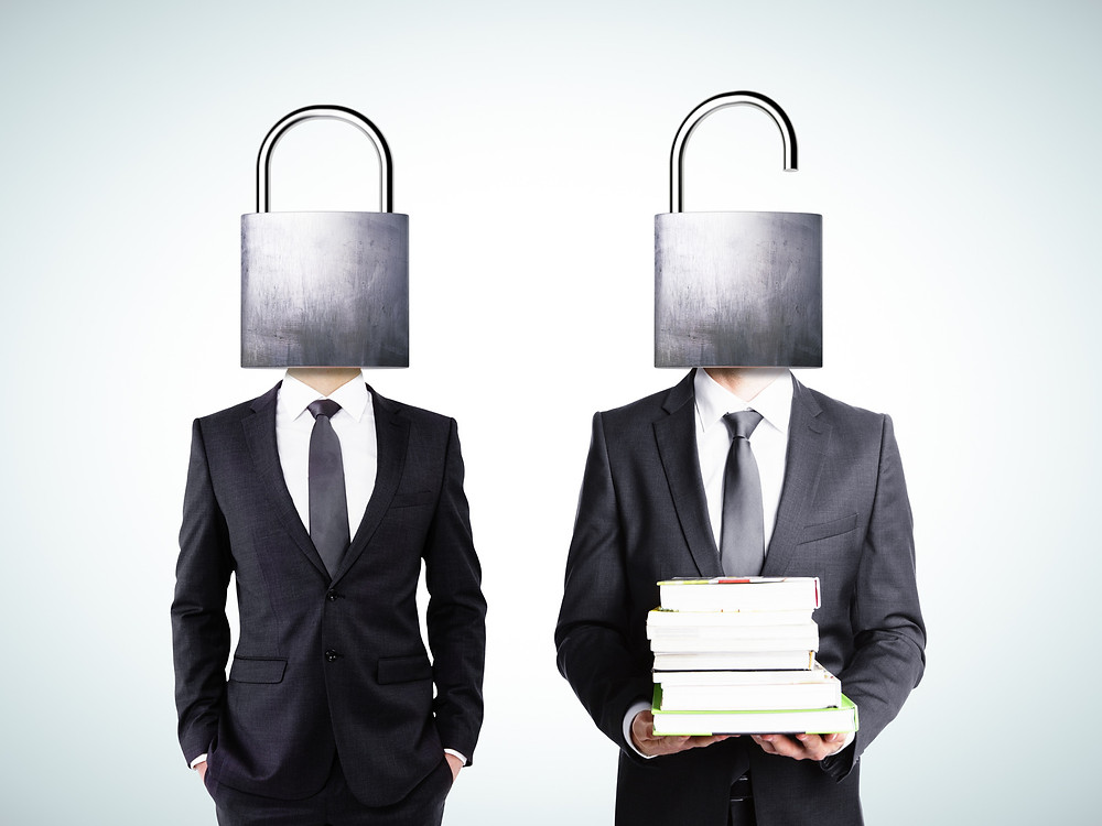 Image of two men in suits with locks as their heads