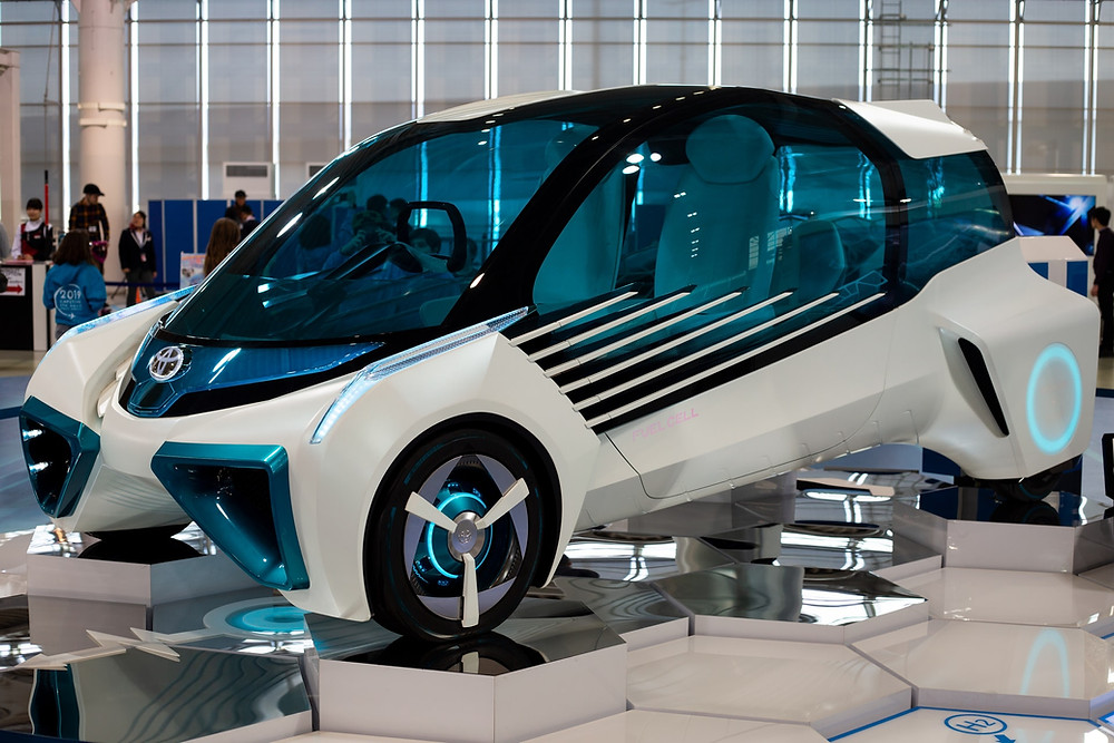 A Toyota hydrogen fuel cell concept vehicle on display at Megaweb Toyota City Showcase in Tokyo.