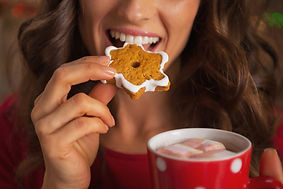 woman-eating-cookie-and-hot-chocolate-wi