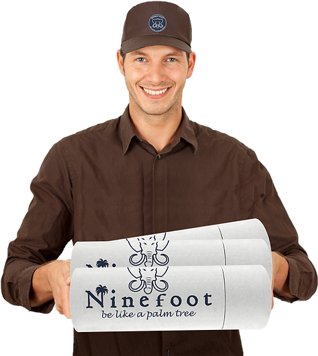 Smiling delivery man with in his hands some tubes of happiness from Ninefoot