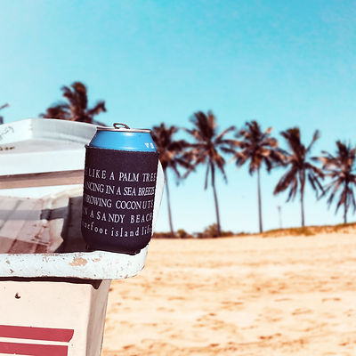 Ninefoot Koozie stubbie holder photographed on a boat on the beach