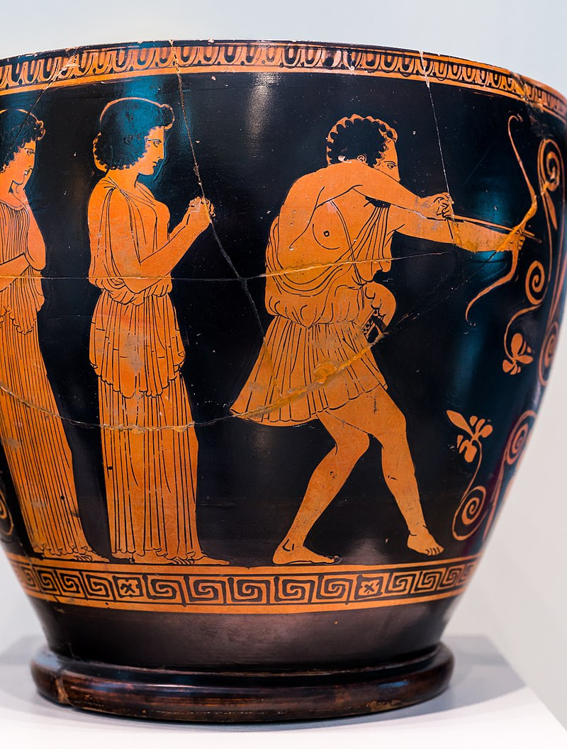 A photograph of a black-and-orange Attic pottery vase depicting Odysseus in disguise as a beggar shooting his bow toward the suitors who are not visible; behind him, Penelope holds her hands together and watches with a serving maid