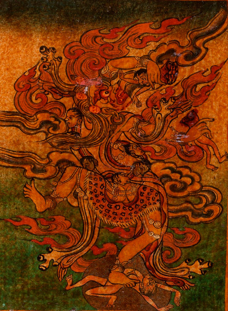 An ancient wood painting of a Tibetan deity wearing a leopardskin, dancing in a cloud of fire while pulling decapitated humans from its body