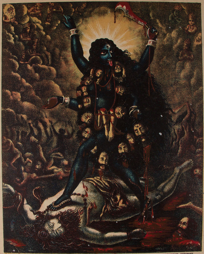 A traditional painting of the Hindu goddess Kali, depicting her with black skin, wearing a necklace of severed heads and limbs, brandishing a blade which drips blood onto her long tongue as she stands on the unconscious body of her husband, the god Shiva