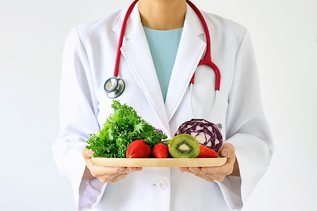 Doctor holding fresh fruit and vegetable