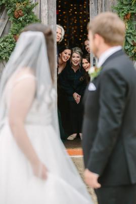 Bridal party peeking at first look