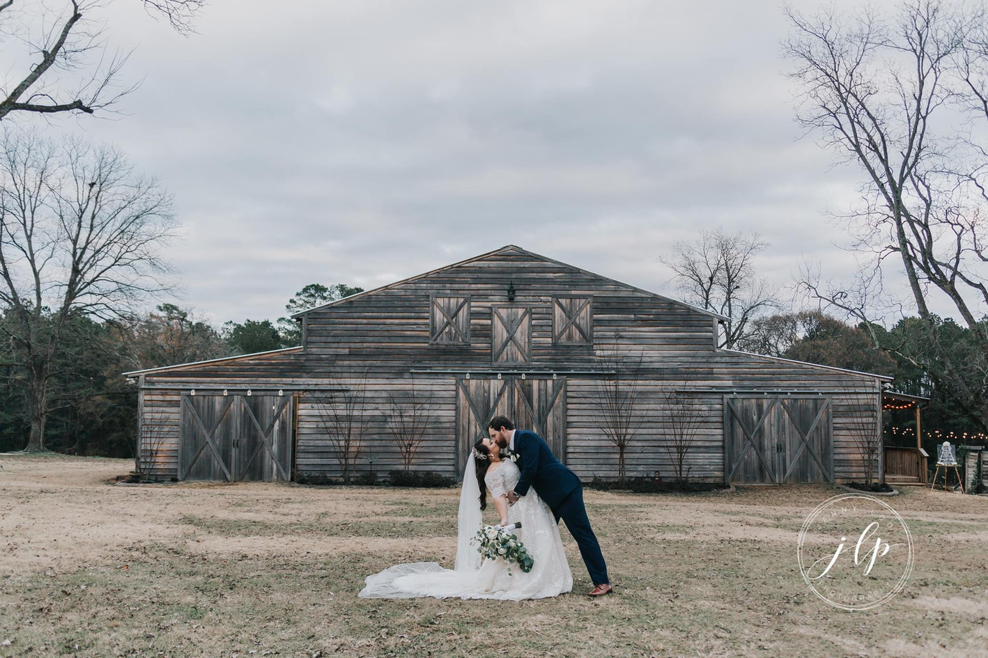 Jacey & Blake in front of new barn.jpg