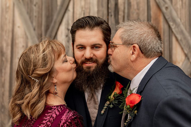 Colby with parents.jpg