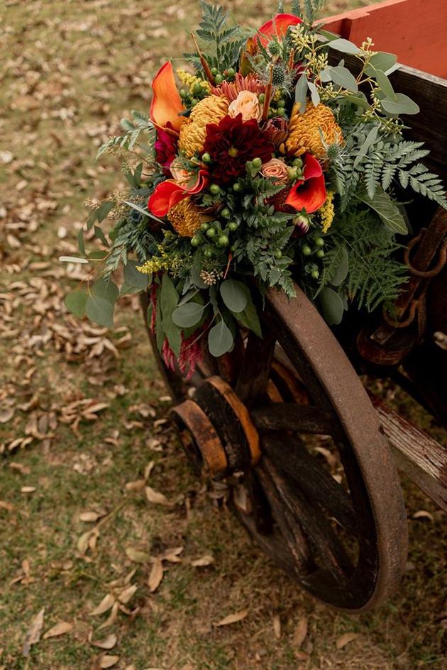 bouquet on wagon wheel.jpg