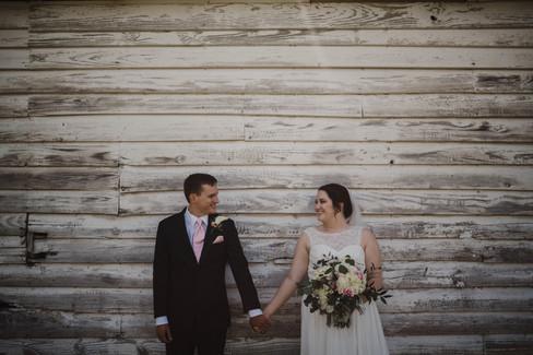 Caroline & Brett by side of old barn.jpg