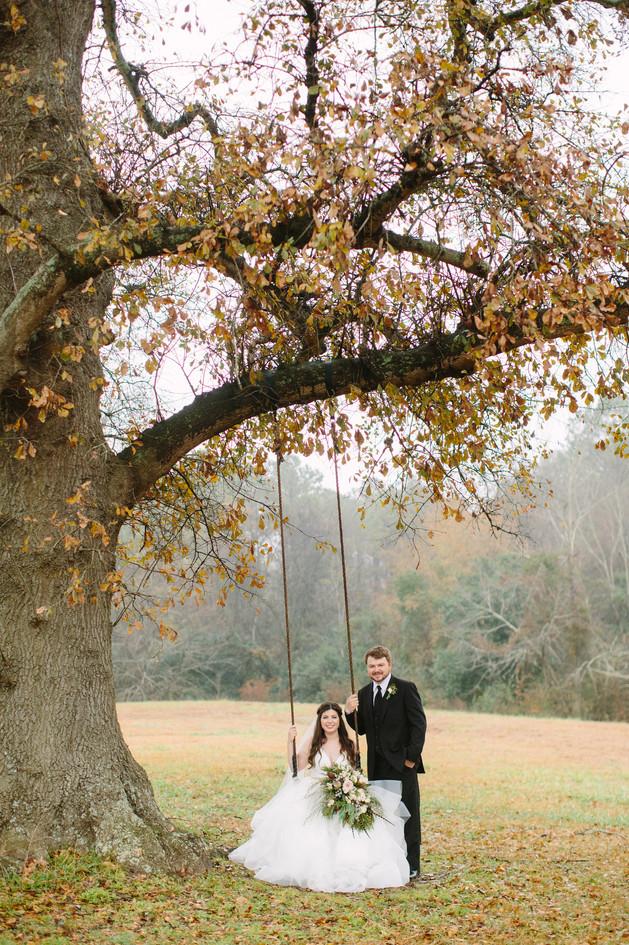 Nathan beside Chloe in tree swing