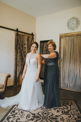Mom helping with dress